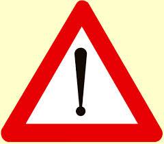 Panneau routier Attention